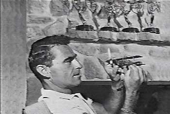 Rod Serling at home with his Emmys