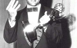 Rod Serling holding his forth Emmy